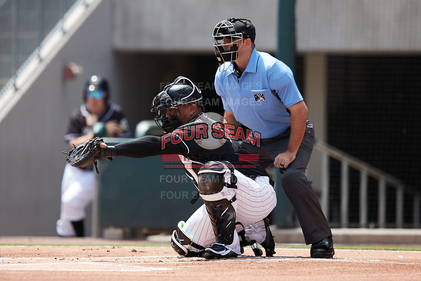 Charlotte Knights catcher Yermin Mercedes (73) frames a pitch as home plate umpire Ben Sonntag looks on during the game against the Durham Bulls at Truist Field on August 28, 2021 in Charlotte, North Carolina. (Brian Westerholt/Four Seam Images)