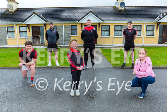 Rathmore GAA players who will collectively run 1500km over the next two weeks in a fundraising challenge for the Rathmore branch of the Kerry Mental Health association and the Irish Cancer Society Killarney/South Kerry night nurses service l-r: Mark Reen, Cillian O'Connor, Ruby, Derek and John Moynihan with Catriona Lawlor Teach Mhuire