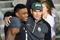 Baylor Head Coach Art Briles greets wide receiver Antwan Goodley (5) as he takes the field to play his final collegiate career NCAA football game, Saturday, December 06, 2014 in Waco, Tex. Baylor defeated Kansas State 38-27. (Mo Khursheed/TFV Media via AP Images)