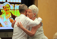 NO SALES, NO AGENCIES, NO LOCAL OR NATIONAL PRESS, NO MAGAZINES.<br /> ONLY FOR BLACKPOOL COUNCIL WEBSITE, FACEBOOK, TWITTER, INTERNAL PUBLICATIONSCOPY BY TOM BEDFORD<br /> Pictured: Pat Stewart (R) is hugged by Tony Sharkey in Blackpool Library.<br /> Re: A pin-up girl from the 1950s has returned to the spot where she accidentally flashed her knickers and won the nation's hearts.<br /> Pat Stewart was a teenage dancer when she and a pal were persuaded to pose for a picture on Blackpool seafront.<br /> As the camera clicked a gust of wind lifted her skirt to give just a glimpse of forbidden flesh.<br /> Pat became known as the girl in the spotty dress and it helped kick-off her showbusiness career.<br /> And 65 years later Pat posed on the same spot after returning to Blackpool for the first time since the saucy snap was taken.£150 MINIMUM FOR NEWSPAPER USE PLEASE