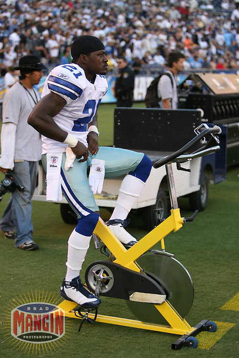 SAN DIEGO - AUGUST 9:  Adam (Pac Man) Jones of the Dallas Cowboys rides the stationary bike on the sidelines during their exhibition game against the San Diego Chargers at Qualcomm Stadium in San Diego, California on August 9, 2008.  Photo by Brad Mangin