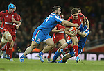 Wales replacement scrum half Rhys Webb bursts a gap between Italian replacements Alberto De Marchi and Lorenzo Cittadini.<br /> RBS 6 Nations 2014<br /> Wales v Italy<br /> Millennium Stadium<br /> 01.02.14<br /> <br /> ©Steve Pope-SPORTINGWALES