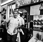 Black and White portrait of barber on Montana Ave. in Santa Monica, California