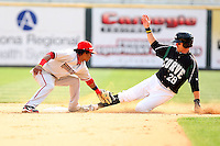 April 11, 2010:  Second Baseman Michael Martinez of the Harrisburg Senators tags Miles Durham who was called safe during a game at Blair County Ballpark in Altoona, PA.  Harrisburg is the Double-A Eastern League affiliate of the Washington Nationals.  Photo By Mike Janes/Four Seam Images