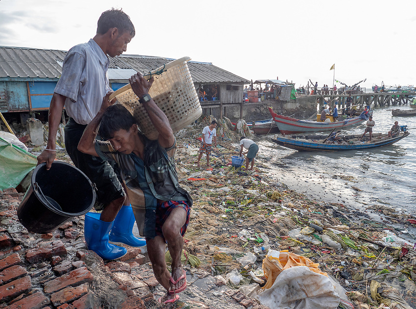 Street life and street scenes in Sittwe, the capital of Rakhine State, Myanmar (Burma) Environment and plastic on the shore line