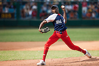 15 Februray 2009: Left pitcher Aroldis Chapman of the Orientales pitches during a training game of Cuba Baseball Team for the World Baseball Classic 2009. The national team is pitted against itself, divided in two teams called the Occidentales and the Orientales. The Orientales win 12-8, at the Latinoamericano stadium, in la Habana, Cuba.