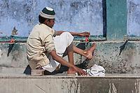Madrasa Student Performing Ablutions before Prayers, Madrasa Islamia Arabia Izharul-Uloom, Dehradun, India.