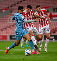 21st April 2021; Bet365 Stadium, Stoke, Staffordshire, England; English Football League Championship Football, Stoke City versus Coventry; Danny Batth of Stoke City tackles Tyler Walker of Coventry City