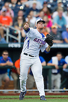 Florida Gators pitcher Logan Shore (32) makes a throw to first base against the Miami Hurricanes in the NCAA College World Series on June 13, 2015 at TD Ameritrade Park in Omaha, Nebraska. Florida defeated Miami 15-3. (Andrew Woolley/Four Seam Images)