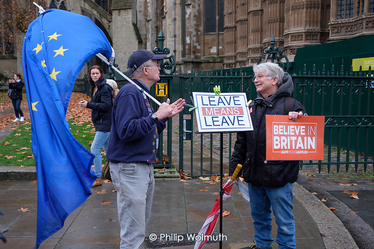 Leave Means Leave.  Pro and anti-Brexit protesters argue outside the Houses of Parliament as MPs debate the government's Brexit deal, Westminster, London.