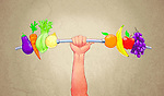 Illustrative image of human hand holding barbell with fruits and vegetables representing healthy lifestyle