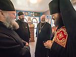 Archimandrite Irinei, greets the monks and clergy during the First Monastic Liturgy, St. Silhouan Monastery, Columbia, California.