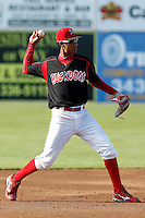 Batavia Muckdogs shortstop Cesar Valera #14 during the first game of a doubleheader against the Williamsport Crosscutters at Dwyer Stadium on August 23, 2011 in Batavia, New York.  Batavia defeated Williamsport 2-1.  (Mike Janes/Four Seam Images)