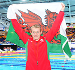 Wales' Jack Thomas poses with the Welsh flag after taking the bronze medal in the men's para-sport 200m freestyle S14 final<br /> <br /> Photographer Chris Vaughan/Sportingwales<br /> <br /> 20th Commonwealth Games - Day 3 - Saturday 26th July 2014 - Swimming - Tollcross International Swimming Centre - Glasgow - UK