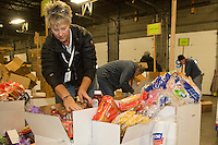 Volunteer Leslie Washburn sorts and packs human food for the volunteers which will be working at the 20+ checkpoints durinig this year's 2016 Iditarod Race at the Airland Transport warehouse in Anchorage on Friday, February 19, 2016.