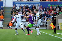 Martin Olsson of Swansea City vies for possession with Callum O'Dowda of Bristol City during the Sky Bet Championship match between Swansea City and Bristol City at the Liberty Stadium, Swansea, Wales, UK. Saturday 25 August 2018