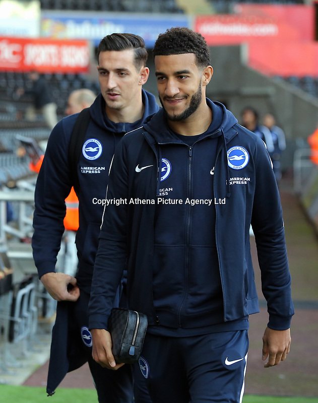 Lewis Dunk of Brighton (L) arrives prior to the game during the Premier League match between Swansea City and Brighton and Hove Albion at The Liberty Stadium, Swansea, Wales, UK. Saturday 04 November 2017