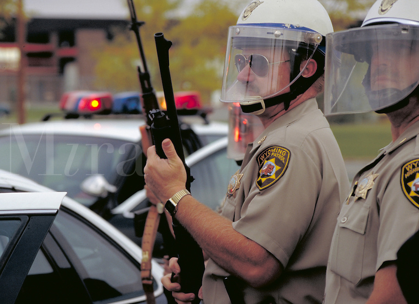 Wyoming Highway Patrolmen in riot gear, police officers, armed cops, artillery, intimidation. Casper Wyoming USA.