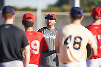 Jacob Cruz coaches for the Brewers during the Under Armour Baseball Factory Recruiting Classic at Gene Autry Park on December 30, 2017 in Mesa, Arizona. (Zachary Lucy/Four Seam Images)