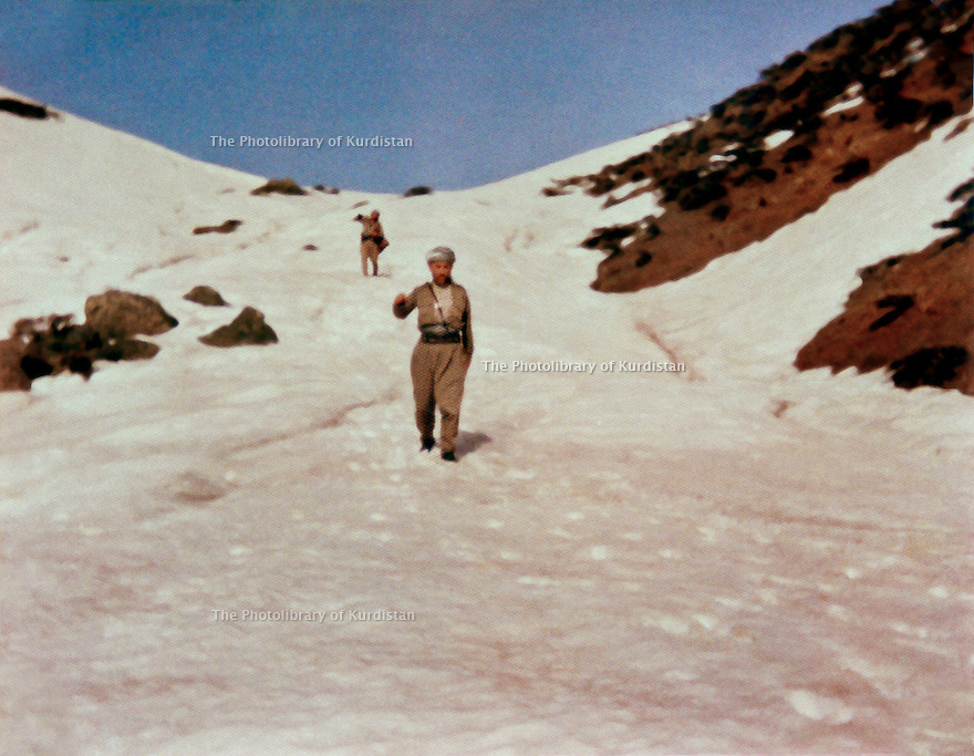 Iraq 1980 .Akram Agha walking in the snow in april on the border of Iran .Irak 1980 .Le 10 avril, Akram Agha marchant dans la neige a la frontiere avec l'Iran