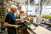 BNPS.co.uk (01202 558833)<br /> Pic: MaxWillcock/BNPS<br /> <br /> Pictured: Pictured: Ray using his original 1960s shop till that still works.<br /> <br /> Tireless Ray Fisher still works full-time in the motorcycle shop he opened 62 years ago - and he has plenty left in the tank.<br /> <br /> The 85 year old founded Ray Fisher's Brickbits in Christchurch, Dorset, in 1959 after training as a bike mechanic.<br /> <br /> It is a family affair as his two children Gerry, 58, and Stephanie, 54, have both worked solely for him since leaving school aged 16.<br /> <br /> Ray said he had loved bikes since childhood and learnt how to repair them while doing national service in the early 1950s.