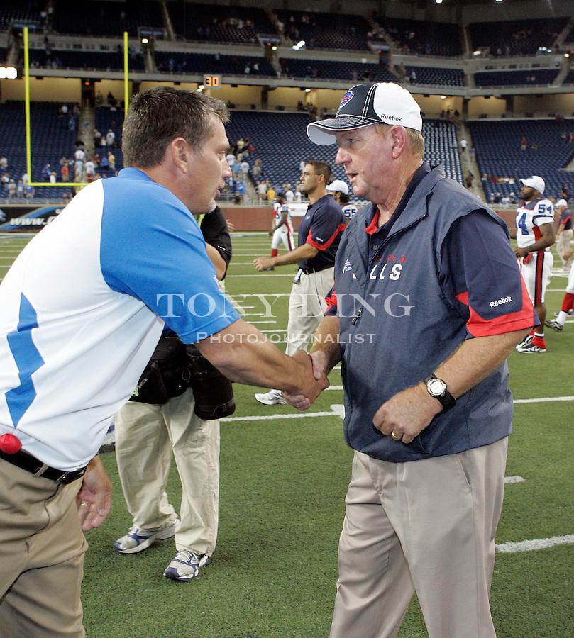 Detroit Lions head coach Jim Schwartz, left, shakes hands with Buffalo Bills head coach Chan Gailey after a preseason NFL football game, Thursday,  Sept. 2, 2010, in Detroit. The Lions won 28-23. (AP Photo/Tony Ding)