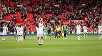 Pictured: Jonjo Shelvey and team mates thank supporters after the end of the game. Saturday 16 August 2014<br />