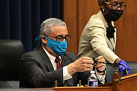 United States House Education and Labor Committee   Chairman US Representative Bobby Scott (Democrat of Virginia), left, puts a cloth cover over his microphone to prevent the chance of transmission of coronavirus during a hearing about the federal government's role in protecting workers during the pandemic on Capitol Hill May 28, 2020 in Washington, DC. More than 62,000 health care workers have been infected with COVID-19 and close to 300 have died according to the U.S. Centers for Disease Control.<br /> Credit: Chip Somodevilla / Pool via CNP/AdMedia