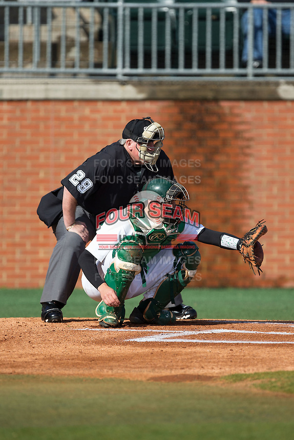 Charlotte 49ers catcher Nick Daddio (20) sets a target as home plate umpire Scott Graham looks over his shoulder during the game against the Florida Atlantic Owls at Hayes Stadium on March 14, 2015 in Charlotte, North Carolina.  The Owls defeated the 49ers 8-3 in game one of a double header.  (Brian Westerholt/Four Seam Images)