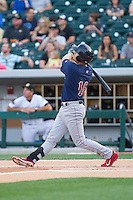 Reid Brignac (16) of the Lehigh Valley IronPigs follows through on his swing against the Charlotte Knights at BB&T Ballpark on May 8, 2014 in Charlotte, North Carolina.  The IronPigs defeated the Knights 8-6.  (Brian Westerholt/Four Seam Images)