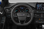 Car pictures of steering wheel view of a 2018 Ford Focus ST Line Business 4 Door Hatchback