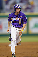 LSU Tigers outfielder Mark Laird #9 runs to third base during the Southeastern Conference baseball game against the Georgia Bulldogs on March 22, 2014 at Alex Box Stadium in Baton Rouge, La. The Tigers defeated the Bulldogs 2-1. (Andrew Woolley/Four Seam Images)