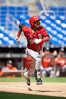 Washington Nationals catcher Alejandro Flores (19) runs to first base during a Florida Instructional League game against the Miami Marlins on September 26, 2018 at the Marlins Park in Miami, Florida.  (Mike Janes/Four Seam Images)