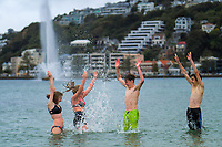 Emilie Wilcock, Holly Robb, Conor Excell and Jack Blackwell  swim in Oriental Bay during Alert Level 2 COVID-19 pandemic civil emergency conditions in Wellington, New Zealand on Saturday, 16 May 2020. Photo: Dave Lintott / lintottphoto.co.nz
