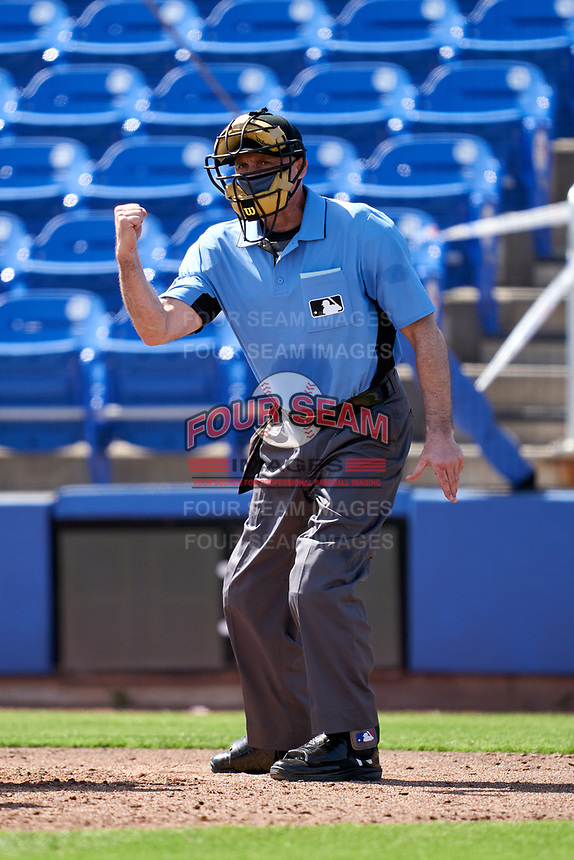 Umpire Dan Iassogna calls a strike during a Toronto Blue Jays Major League Spring Training game against the Pittsburgh Pirates on March 1, 2021 at TD Ballpark in Dunedin, Florida.  (Mike Janes/Four Seam Images)