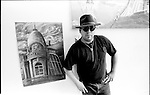 A US born Mexican poses for a photograph in his studio located in the west side of Chicago Illinois. Photo by Heriberto Rodriguez