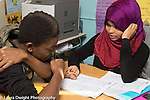education high school classroom male and female students working together girl wearing hijab