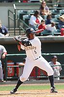 Charleston RiverDogs designated hitter Miguel Andujar #5 at bat during a game against the Greenville Drive at Joseph P. Riley Jr. Ballpark  on April 9, 2014 in Charleston, South Carolina. Greenville defeated Charleston 6-3. (Robert Gurganus/Four Seam Images)