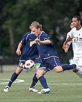 Quinnipiac University defender Matthew Rothbart (14) clears the ball. Boston College defeated Quinnipiac, 5-0, at Newton Soccer Field, September 1, 2011.