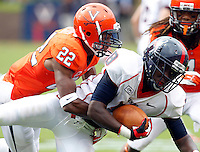 Virginia Cavaliers cornerback Drequan Hoskey (22) tackles Richmond Spiders wide receiver Rashad Ponder (8) during the first half of the NCAA football game Saturday September, 1, 2012 at Scott Stadium in Charlottesville, Va.