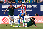Angel Correa of Atletico de Madrid (C) in action during the La Liga match between Atletico de Madrid vs Osasuna at the Estadio Vicente Calderon on 15 April 2017 in Madrid, Spain. Photo by Diego Gonzalez Souto / Power Sport Images