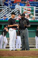 Batavia Muckdogs manager Mike Jacobs (17) argues a overturned foul ball call with umpire James Jean during a game against the State College Spikes on July 7, 2018 at Dwyer Stadium in Batavia, New York.  State College defeated Batavia 7-4.  (Mike Janes/Four Seam Images)