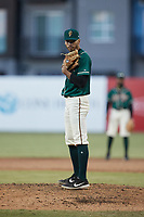 Greensboro Grasshoppers relief pitcher Alexander Manasa (28) looks to his catcher for the sign against the Hickory Crawdads at First National Bank Field on May 6, 2021 in Greensboro, North Carolina. (Brian Westerholt/Four Seam Images)