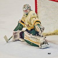 4 January 2014:  University of Vermont Catamount Goaltender Mike Santaguida, a Freshman from Mississauga, Ontario, makes an overtime skate save against the Yale University Bulldogs at Gutterson Fieldhouse in Burlington, Vermont. With an empty net and seconds remaining, the Cats came back to tie the game 3-3 against the 10th seeded Bulldogs. Mandatory Credit: Ed Wolfstein Photo *** RAW (NEF) Image File Available ***