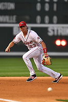 Third baseman Bobby Dalbec (23) of the Greenville Drive chases a grounder in a game against the Lexington Legends on Wednesday, April 12, 2017, at Fluor Field at the West End in Greenville, South Carolina. Greenville won, 4-1. (Tom Priddy/Four Seam Images)