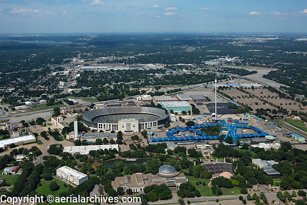 aerial photograph of Fair Park, Dallas, Texas including the Cotton Bowl stadium, the State Fair of Texas Midway, the Texas Star Ferris Wheel and the Leonard Lagoon Nature Walk