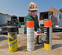 A hazardous waste worker sort through bottles and cans of leftover household chemicals and cleaners dropped off at a hazardous waste disposal site in Westerville, Ohio. Homeowners were able to remove any hazardous waste from their homes to be properly recycled or disposed of instead of placing in their trash or pouring down the drain.<br />