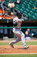 Biloxi Shuckers center fielder Corey Ray (1) follows through on a swing during a game against the Montgomery Biscuits on May 8, 2018 at Montgomery Riverwalk Stadium in Montgomery, Alabama.  Montgomery defeated Biloxi 10-5.  (Mike Janes/Four Seam Images)