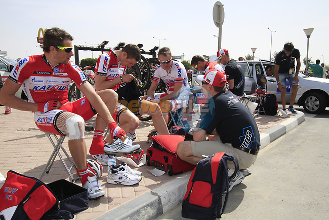 Katusha Team riders Marco Haller (AUT) and Rudiger Selig (GER) get ready before the start of the 3rd Stage of the 2012 Tour of Qatar running 146.5km from Dukhan Souq, Dukhan to Al Gharafa, Qatar. 7th February 2012.<br /> (Photo Eoin Clarke/Newsfile)