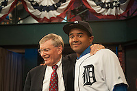 Outfielder Derek Hill (Elk Grove H.S. (CA)) the number 23 overall pick to the Detroit Tigers with Commissioner Bud Selig during the MLB Draft on Thursday June 05,2014 at Studio 42 in Secaucus, NJ.   (Tomasso DeRosa/ Four Seam Images)